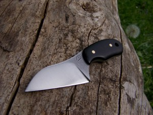 A very small utility or box cutter knife